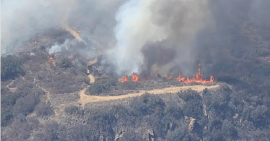 Forward progress of brush fire in Malibu stopped after burning 15 acres, threatening structures